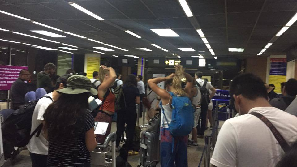 the awfully slow moving taxi lines at the old airport in bangkok, totally avoid this airport